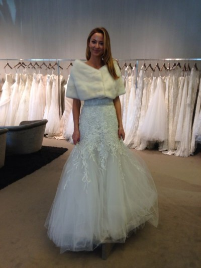 Erica tries on dresses for her December wedding.