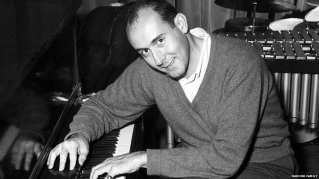Henry Mancini playing piano